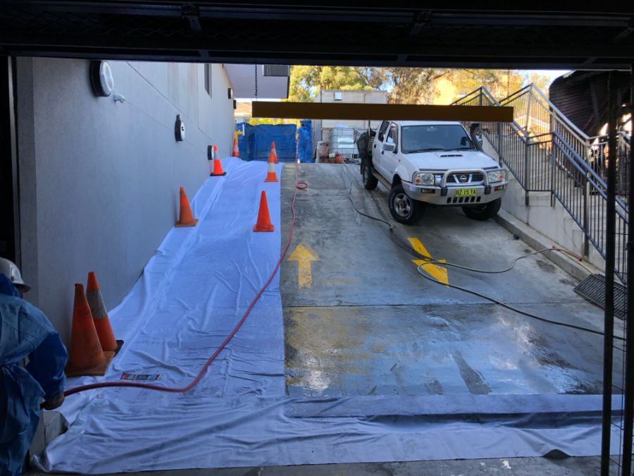 Asbestos Remediation in progress showing car park entry; we are licensed and equipped for both residential and commercial asbestos remediation and abatement
