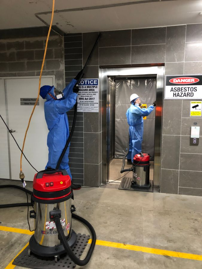 Commercial Asbestos Remediation with highly trained professionals wearing protective gear