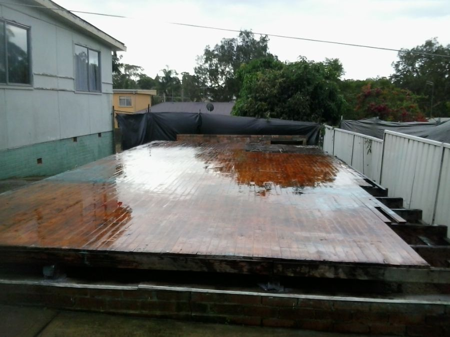 Asbestos removal and house demolition down to the original flooring