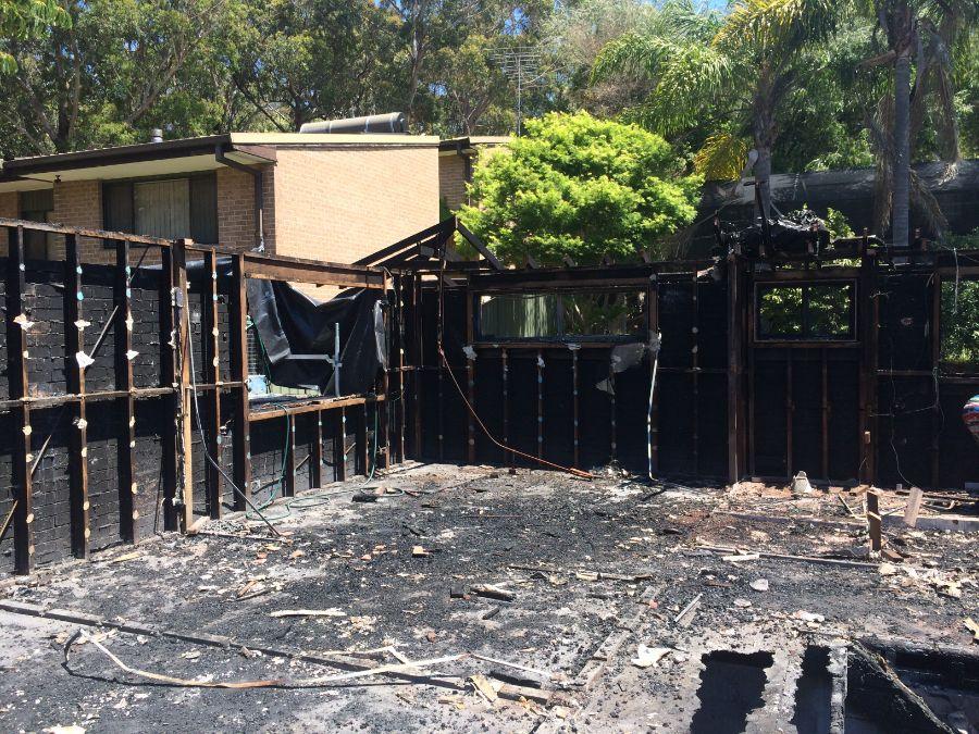 Careful demolition of fire damaged house
