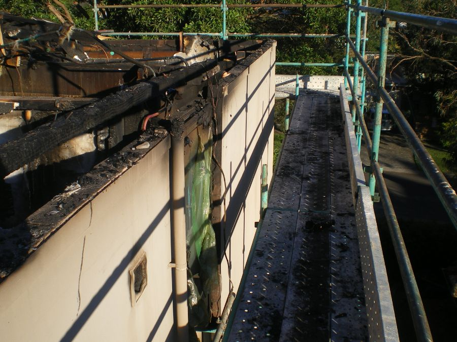 Safe asbestos removal from multi storey fire damaged house requiring partial demolition