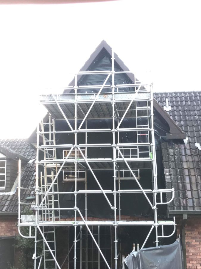 Cost-effective partial house demolition on the Central Coast; scaffolding and protection in place