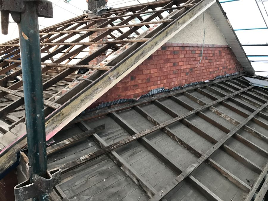 Stepped roof with chimneys for careful asbestos removal